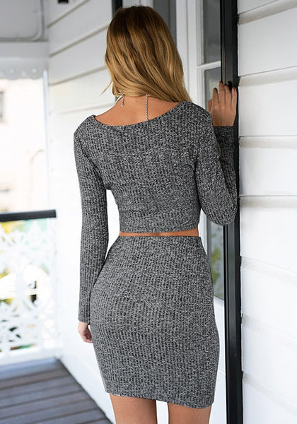 Back view of girl in grey knitted skirt co-ord set
