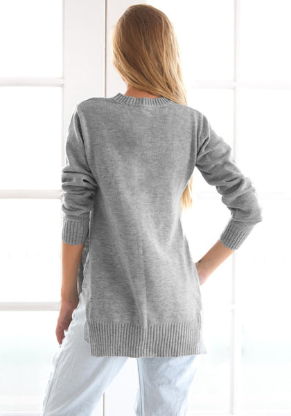 Back view of girl in grey side slit tunic sweater