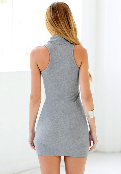 Back view of girl in grey sleeveless turtleneck dress