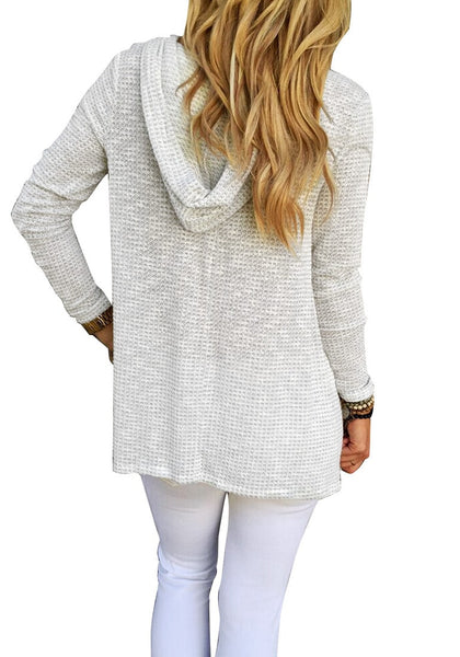 Back view of girl in light grey hooded loose knitted top