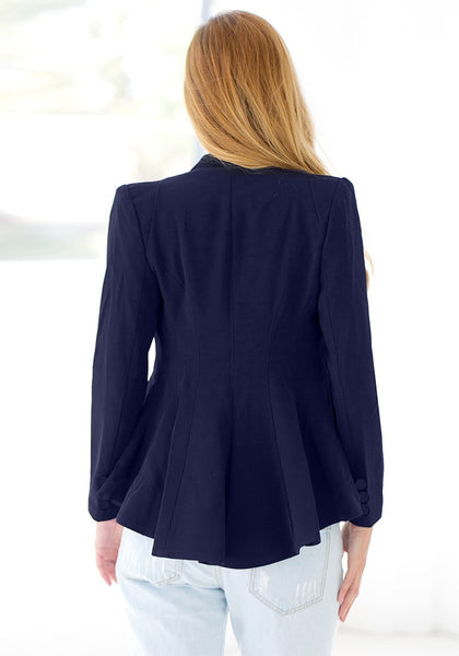 Back view of girl in navy blue double lapel fit-and-flare blazer