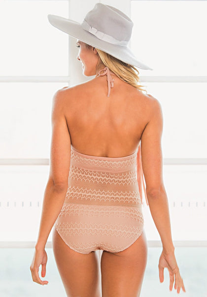 Back view of girl in pink lace fringed halter swimsuit