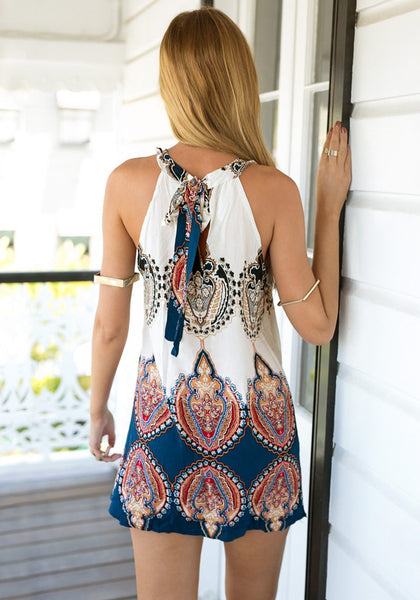 Back view of girl in printed shift dress