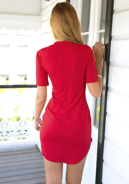 Back view of girl in red curved-hem bodycon dress