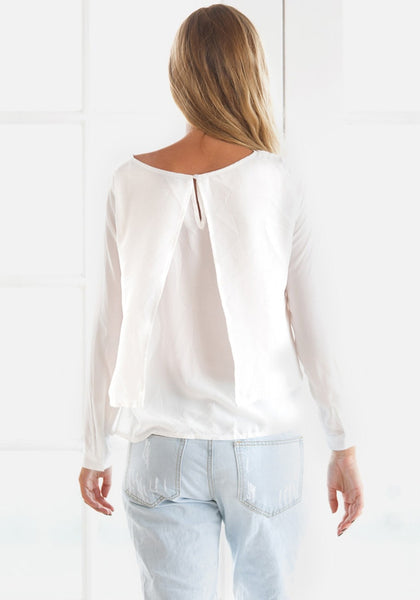 Back view of girl in white layered chiffon blouse
