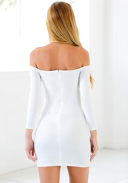 Back view of girl in white off-shoulder mini dress