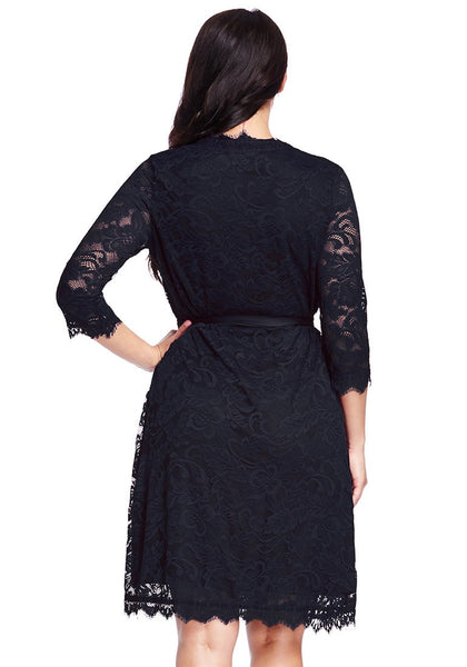 Back view of lady in plus size navy lace crop sleeves wrap dress