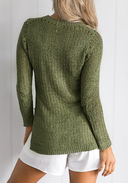 Back view of lady in verdigris green high-low knit sweater