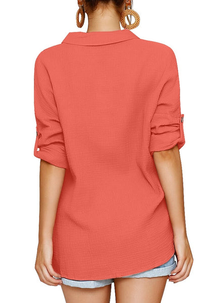 Back view of model earing coral collared V-neckline cuffed sleeves button-up top