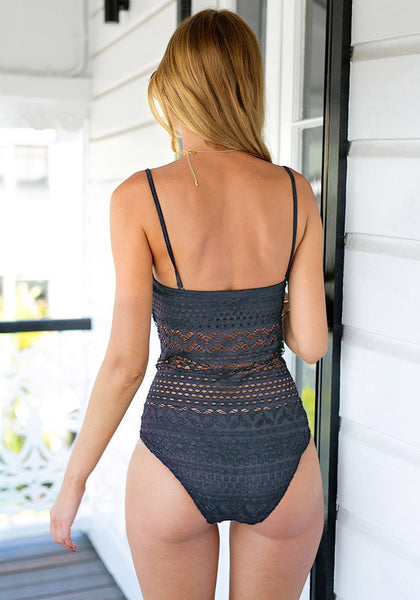 Back view of model in a grey lace halter swimsuit