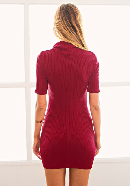 Back view of model in a red ribbed turtleneck bodycon dress