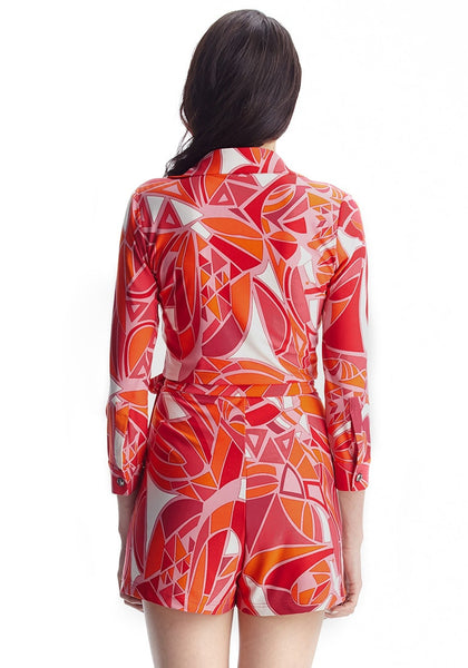 Back view of model in abstract wrap-style long sleeves romper