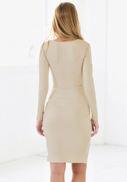Back view of model in apricot draped wrap dress
