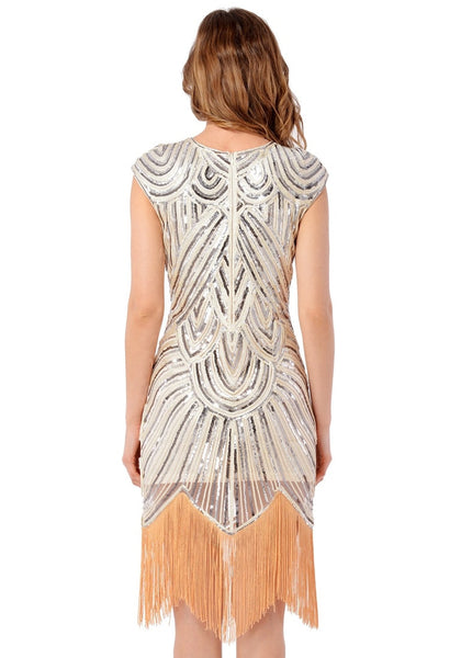 Back view of model in apricot sequin fringed flapper dress