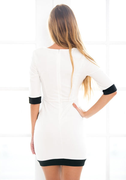 Back view of model in asymmetrical wrap style dress