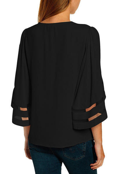 Back view of model in black 34 bell mesh panel sleeves strappy V-neckline loose top