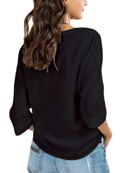 Back view of model in black V-neck 3/4 sleeves knot tie-front blouse