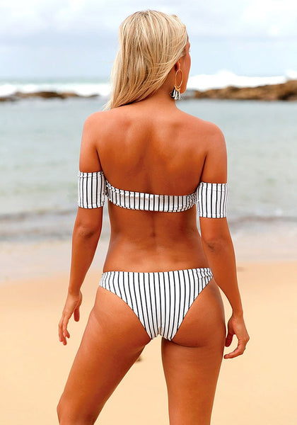 Back view of model in black and white striped off-shoulder bikini set