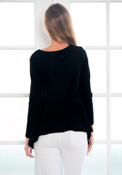 Back view of model in black asymmetrical blouse