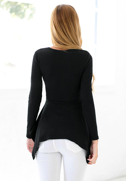 Back view of model in black asymmetrical knit top