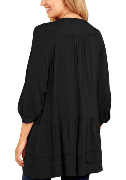 Back view of model in black button-front puffed sleeves tunic