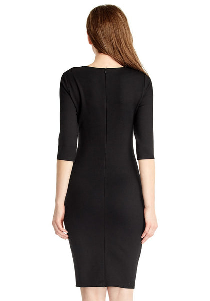 Back view of model in black classic bodycon midi dress
