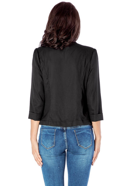 Back view of model in black crop sleeves lapel blazer