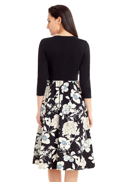 Back view of model in black floral-bottom V neckline crop sleeves skater dress