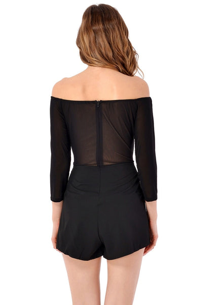 Back view of model in black floral-embroidered off-shoulder romper