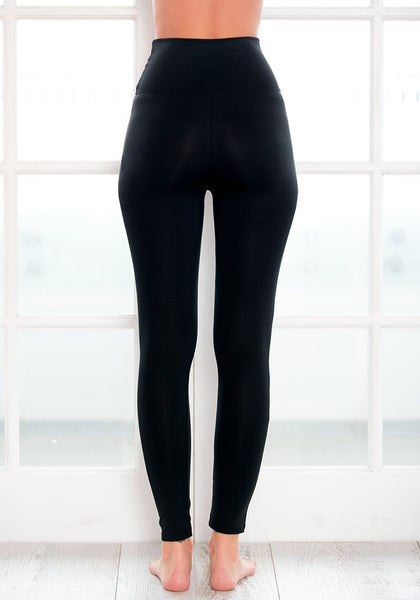 Back view of model in black high-waist leggings