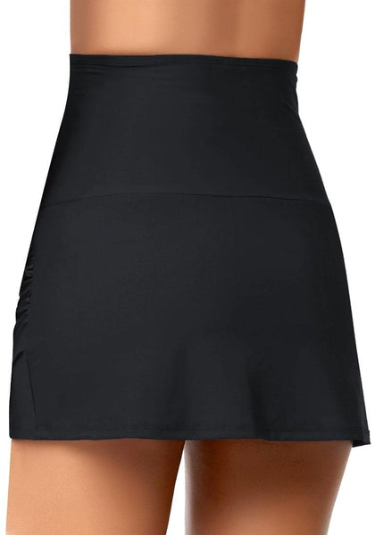 Back view of model in black high-waist tulip hem ruched swim skirt