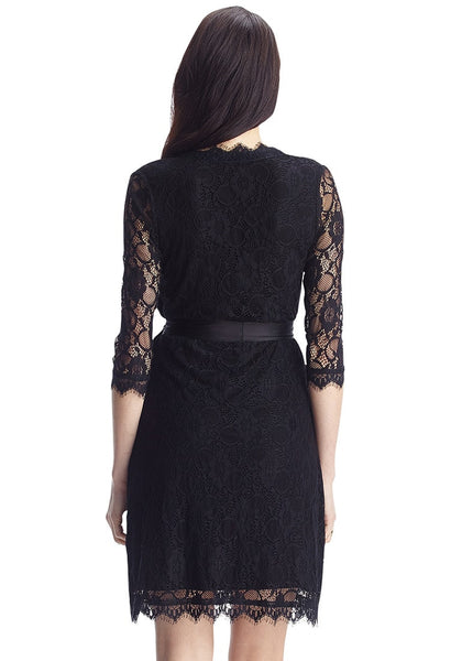 Back view of model in black lace overlay plunge wrap-style dress