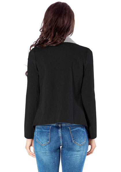 Back view of model in black oblique zipper draped cardigan