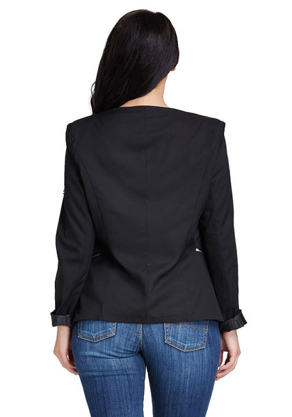 Back view of model in black padded-shoulder draped blazer