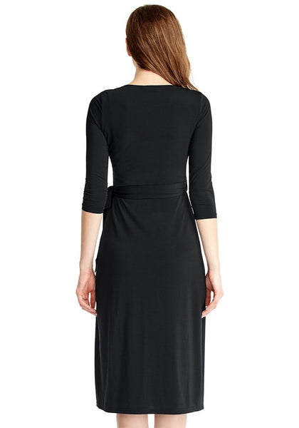 Back view of model in black sweetheart neckline wrap dress (1)