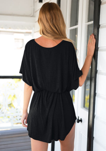 Back view of model in black t-shirt dress
