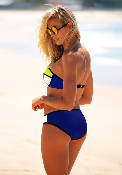 Back view of model in blue contrast color bikini