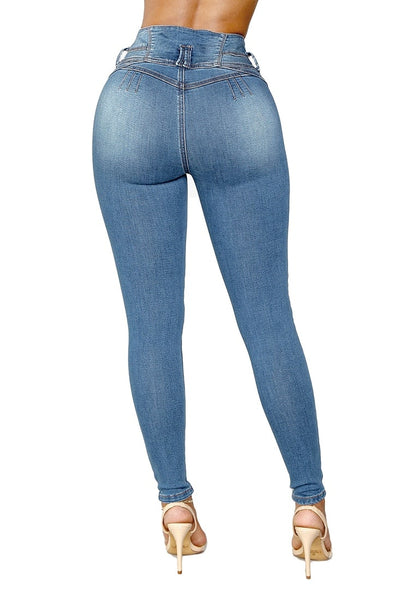 Back view of model in blue triple button washed high waist skinny jeans