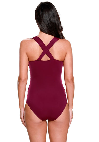 Back view of model in bordeaux crossover ruched swimsuit