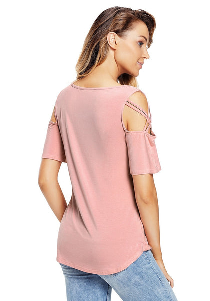 Back view of model in deep blush crisscross cutout shoulder blouse