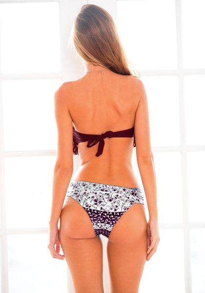 Back view of  model in floral and fringe bikini set