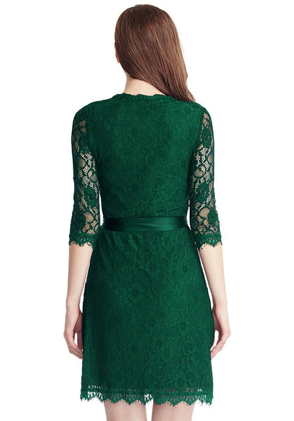 Back view of model in green lace overlay plunge wrap-style dress