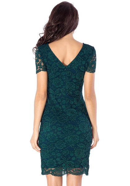 Back view of model in green lace overlay shift dress