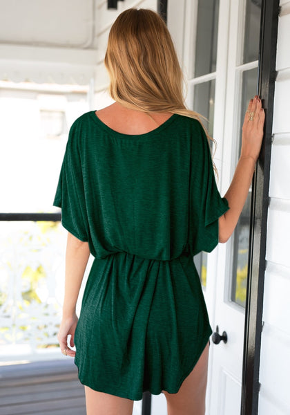 Back view of model in green t-shirt dress