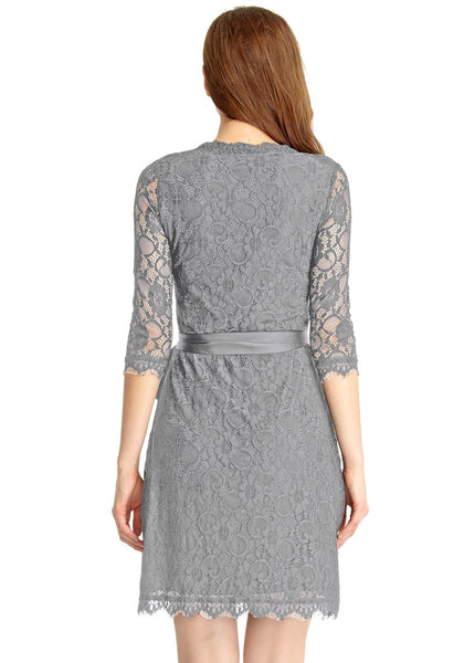 Back view of model in grey lace overlay plunge wrap-style dress