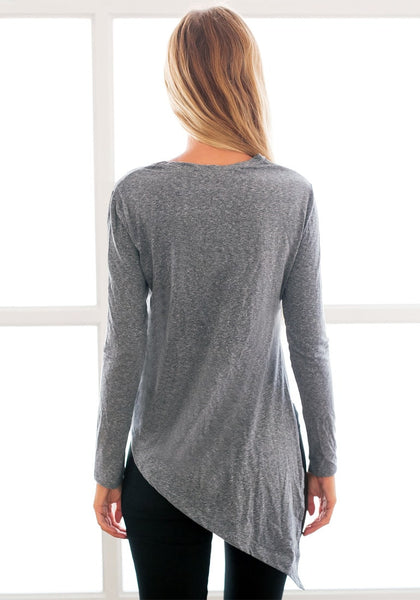 Back view of model in grey side-slit asymmetrical tee