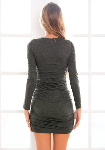 Back view of  model in grey surplice ruched bodycon dress