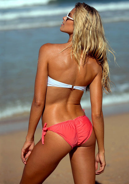 Back view of model in hot pink floral jewelry bikini set