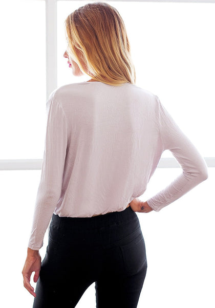 Back view of model in light lavender surplice top