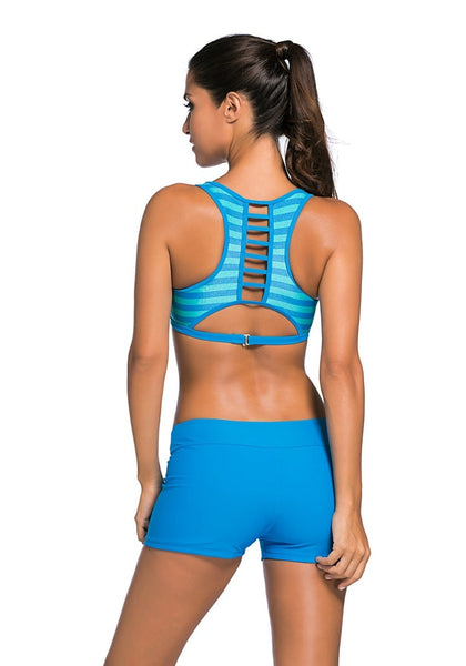 Back view of model in light striped sports bra two-piece set